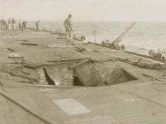 """美航母""""萨拉托加""""号航母甲板上受到来自日本自杀式飞机攻击留下的损伤!.jpg"""